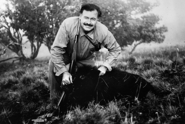 "EH4314P Ernest Hemingway poses with a wild boar at Middle Fork, Salmon River, Idaho, 16 October 1940. Please credit: ""Ernest Hemingway Collection/John F. Kennedy Presidential Library and Museum, Boston."""