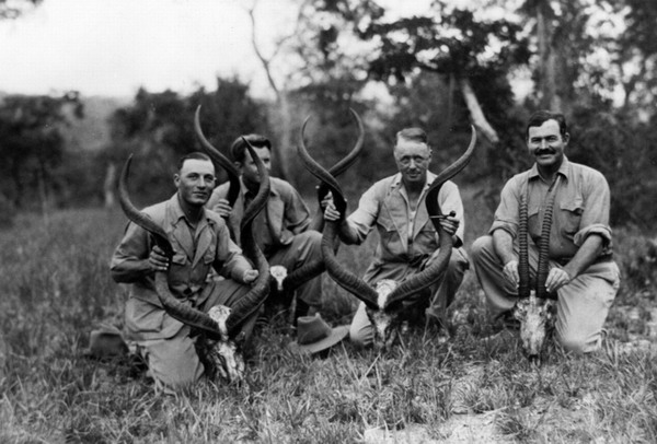 EH 6941P Ben Fourie, Charles Thompson, Philip Percival, and Ernest Hemingway pose with kudu and oryx skulls in Tanganyika, Africa, February 1934. Ernest Hemingway Photograph Collection, John F. Kennedy Presidential Library and Museum, Boston.
